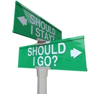 A green two-way street sign pointing to Should I stay or Should I Go with arrows pointing to left or right to compare options